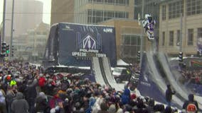 Snowmobile stunt show at Super Bowl LIVE