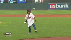 Girl with robotic hand throws pitch at Target Field