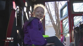 Girl fighting cancer rides in firetruck to surgery
