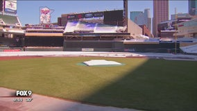 Blankets coming off the grass at Target Field