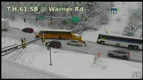 Buses, car stuck on icy U.S. Highway 61 hill in St. Paul