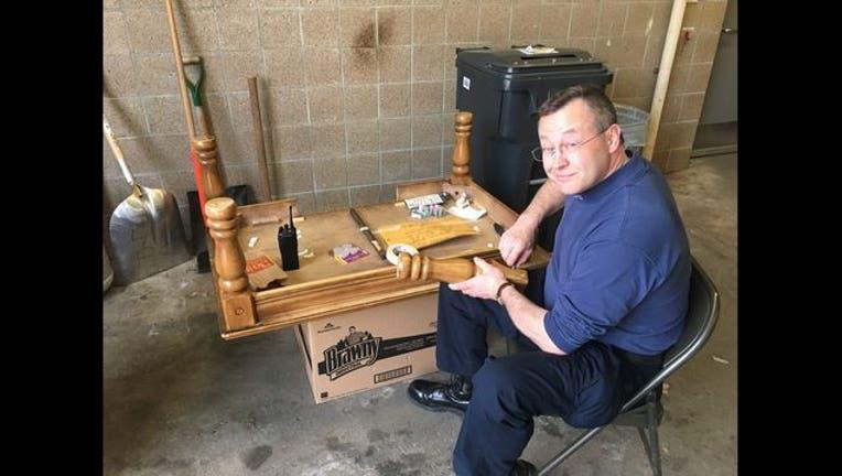 093329ea-MPD officer fixes broken table_1491584809641.jpg