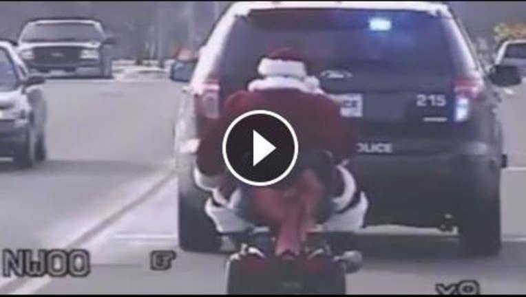 11d0301c-Santa on scooter_1449614269403.JPG