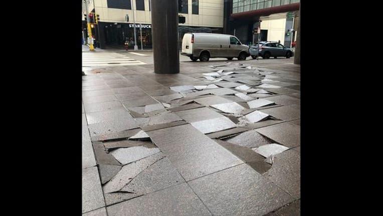 13aa2ea8-Fifth Street Towers damaged pavers