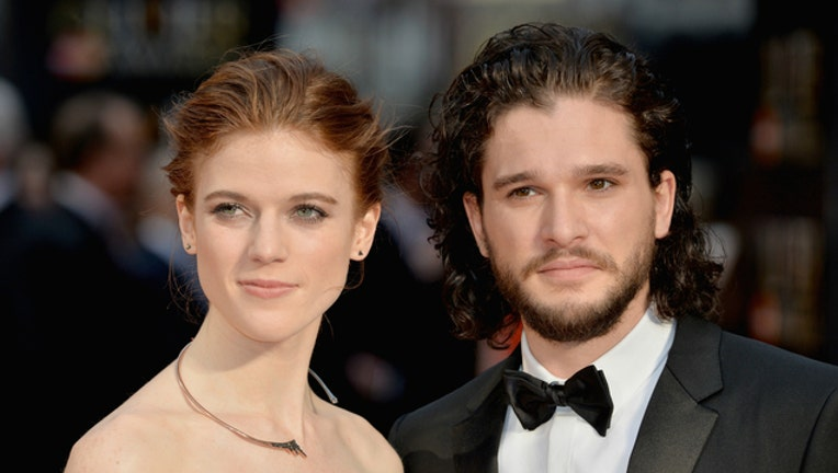 13e515ee-GETTY Kit Harington and Rose Leslie photo by Anthony Harvey-404023