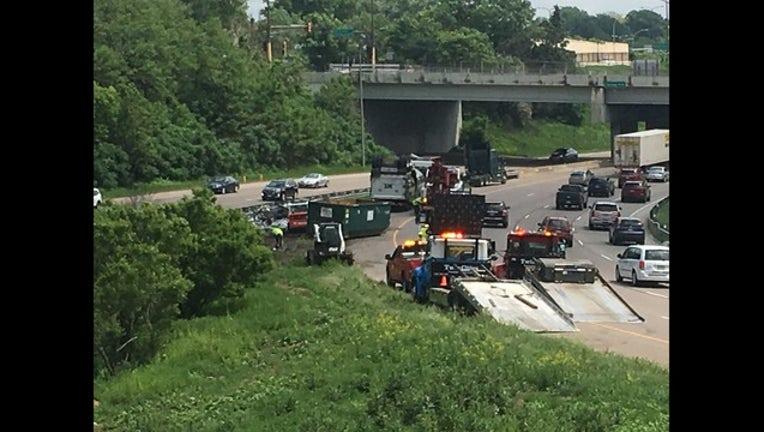 1e310b60-dumpster falls off truck_1527794744176.jpeg.jpg
