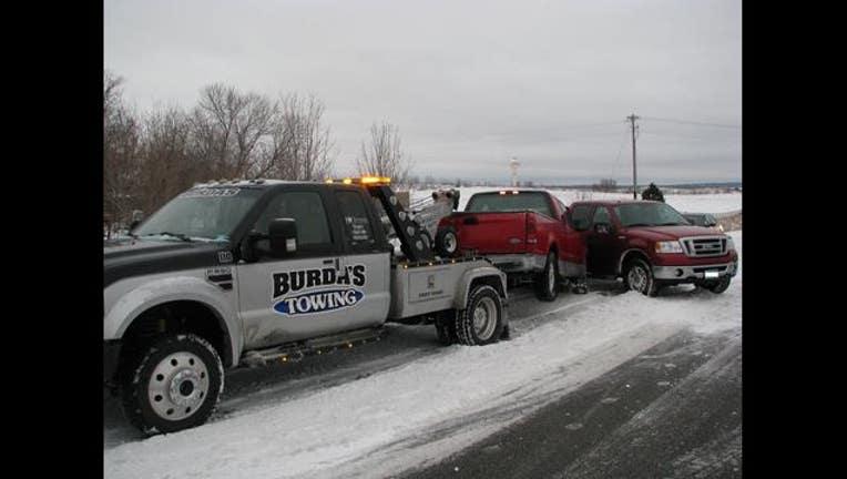 tow truck crash_1451433293410.jpg