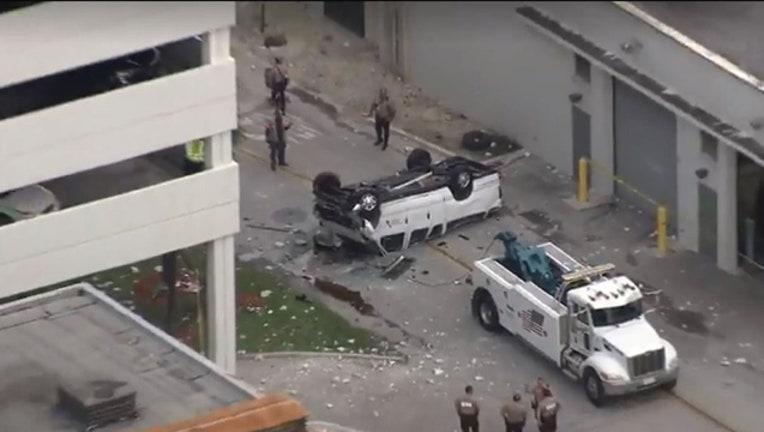 509abc94-car falls from parking garage_1527860748714.jpg-401385.jpg