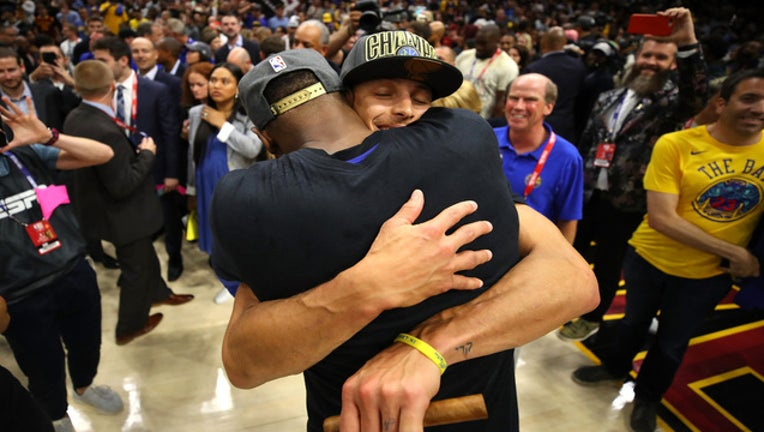 6be1c6a4-GettyImages-Golden-State-NBA-champs2018_1528516252070-402429.jpg