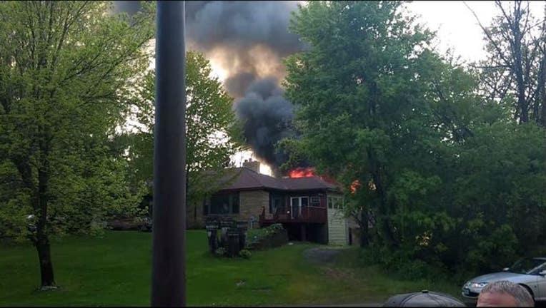 72b72faf-zimmerman flames garage fire_1494899716561.JPG