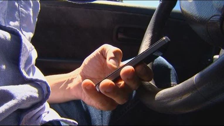 7d3c79ef-hands free cell phone driving bill_1489717891149.JPG