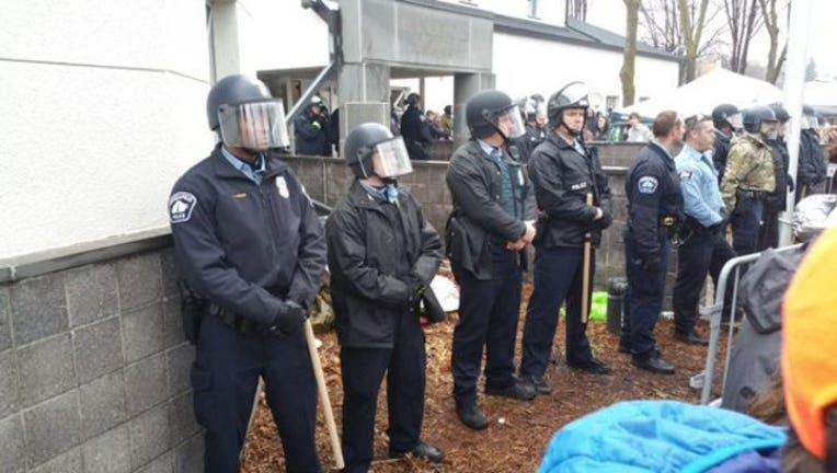 98263bce-police in gear outside precinct_1447881256816.jpg
