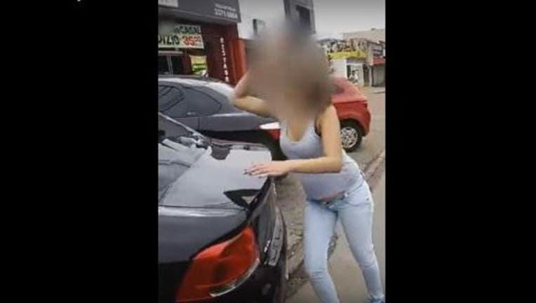 9c8c0a3e-Woman Destroys Husband's Car After Catching Him-407068