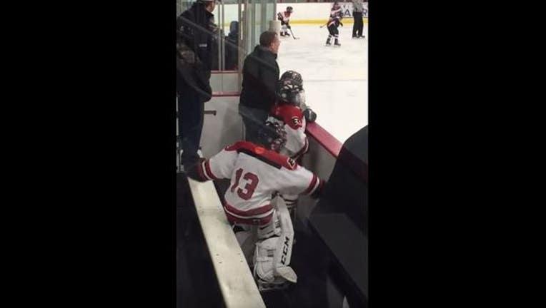 e7463699-young hockey goalie dancing_1452720069436.JPG