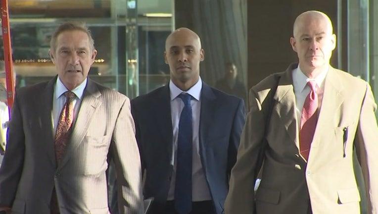 Mohamed Noor walks to court