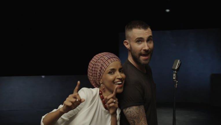 fcae7a44-Ilhan Omar and Adam Levine