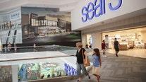 Video shows black SUV speeding through mall in Chicago, crashing into displays