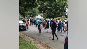 Protesters march in Midway neighborhood after last week's officer-involved shooting in St. Paul, Minn.
