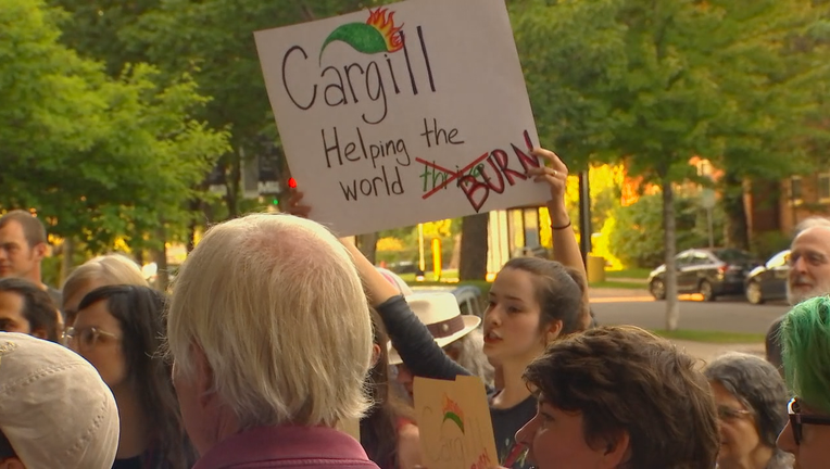 Protester holds sign reading