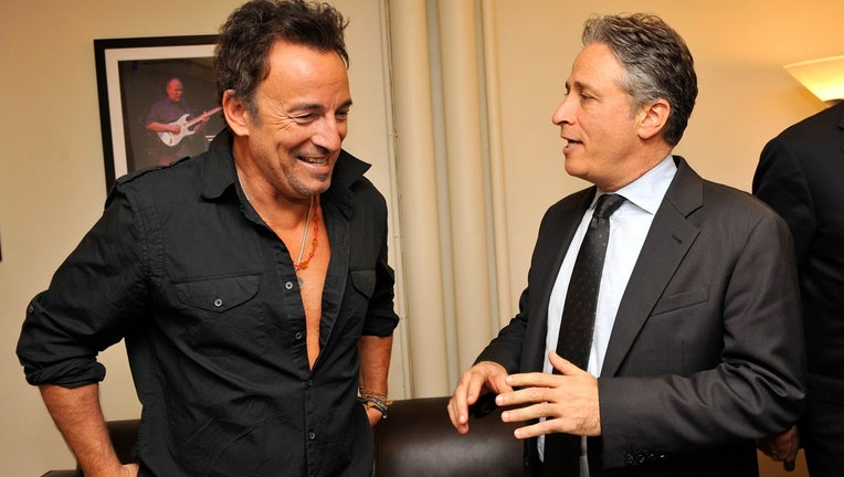 Bruce Springsteen and Jon Stewart backstage at