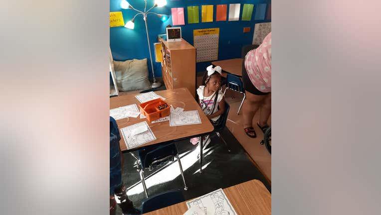Jayda Holmes returns to school