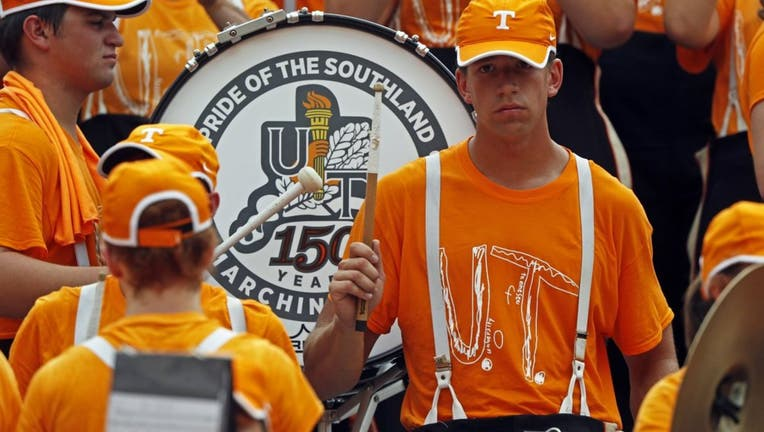a99b5a37-Members of the Pride of the Southland band perform as they wear the University of Tennessee superfan shirt.