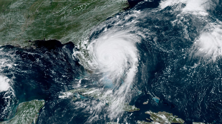 fbcf7e23-In this NOAA GOES-East satellite handout image, Hurricane Dorian, now a Cat. 2 storm, inches northwest away from the Bahamas on September 3, 2019 in the Atlantic Ocean. (Photo by NOAA via Getty Images)