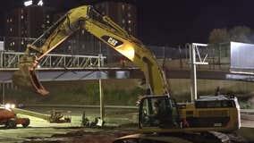 MnDOT crews 'carefully' demolish pedestrian bridge near Augsburg University