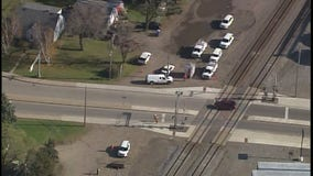 Man drives SUV through crossing gates, is struck by train in Clear Lake, Minn.
