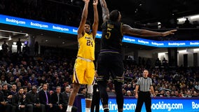 Gophers basketball forward Eric Curry out for season after knee injury