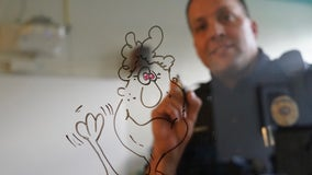 Officer's daily doodles brighten students' days in New Brighton