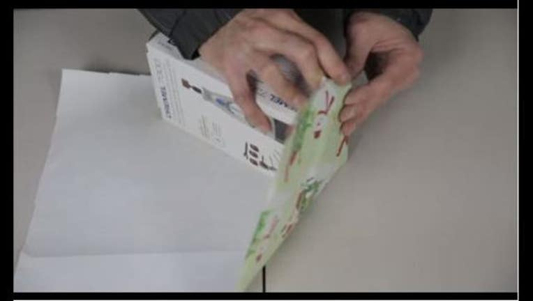 cd6d130e-gift wrapping hack_1450796764526.JPG