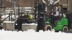 College GameDay workers dig out snow for set-up at University of Minnesota