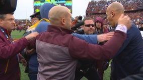 Fleck, Franklin come to photographer's aid during TCF Bank Stadium field rush after Gophers win