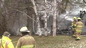 Off-duty volunteer firefighter rescues 2 men from house fire in northeastern Minnesota