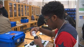 North Minneapolis students make solar-powered briefcase generators to help kids in Africa