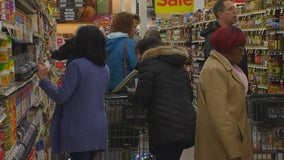 Thanksgiving shoppers rush to stores ahead of winter storm