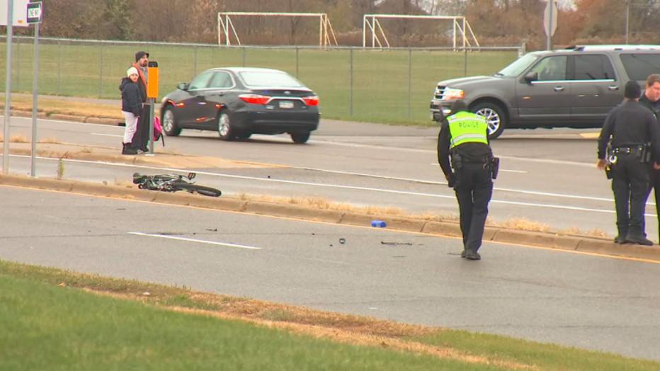 Investigators examine bike crash scene