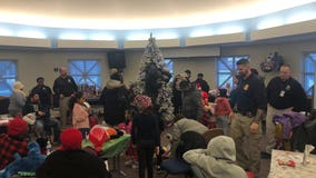A new tradition: Minneapolis Police officers, community members decorate 4th precinct Christmas tree together
