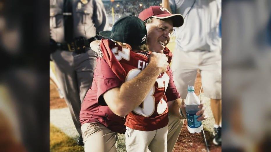 Jimbo Fisher hugs his son