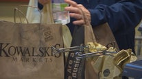 Minnesotans head home early, flock to stores ahead of snowy weather