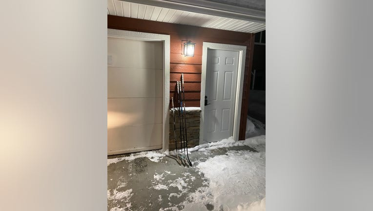 A family leaves hockey sticks outside the front door for #SticksOutForMarshall.