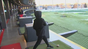 Golfers brave frigid weather to get swings in at Top Golf