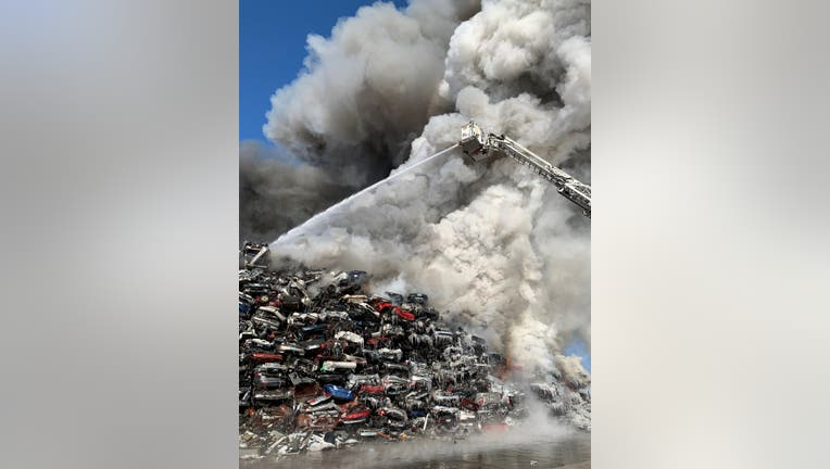Firefighters battle a blaze at Northern Metals in Becker, Minn. two days after it started.