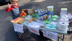 Four-year-old Minnetonka, Minn. boy sets up supplies table to help neighbors
