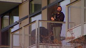 Minneapolis neighbors cheer health care workers from North Loop balconies