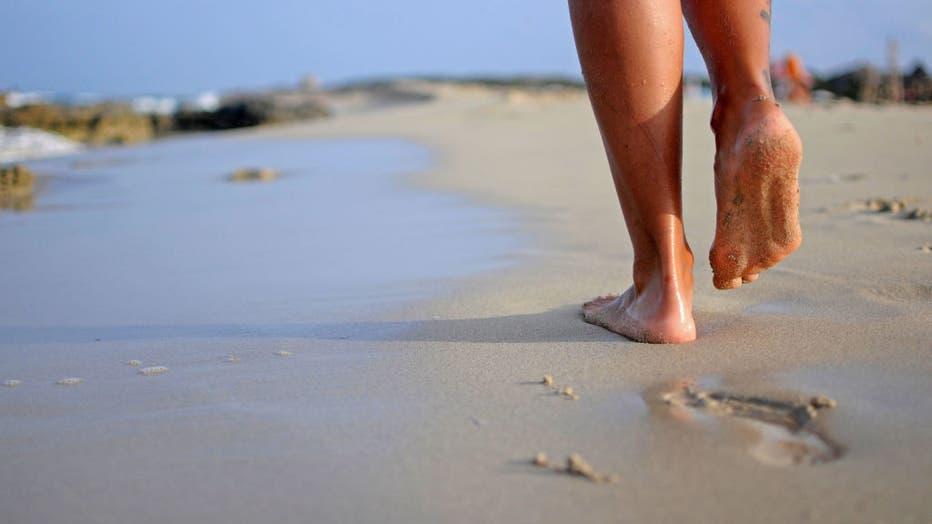 woman walking on the beach