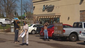 Minnesota Caribou Coffee workers hold car rally to protest working conditions during pandemic