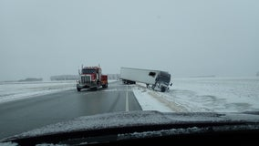 Plow and semi blown off icy road as winter weather persists in northwest Minnesota