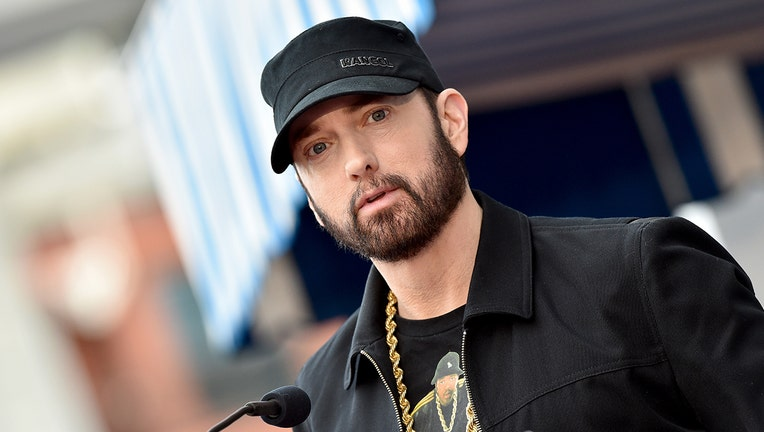 Eminem honoring 50 Cent at the Hollywood Walk of Fam